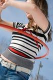 Menina com aro do hula Fotos de Stock Royalty Free