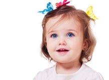 Menina com as borboletas na cabeça Imagem de Stock