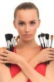 Menina com as escovas para a composição Fotografia de Stock Royalty Free