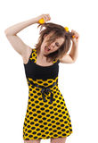 Menina com as esferas amarelas no cabelo isolado no branco Foto de Stock