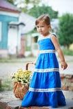 Menina com as flores na cesta Imagens de Stock Royalty Free