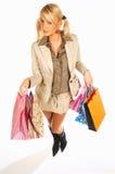 Menina com as mãos cheias dos sacos Imagens de Stock Royalty Free