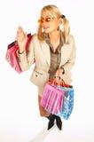 Menina com as mãos cheias dos sacos imagem de stock