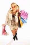 Menina com as mãos cheias dos sacos Fotografia de Stock