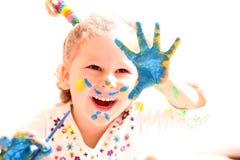 Menina com as mãos da pintura isoladas no branco Foto de Stock Royalty Free