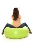 Menina com assento traseiro despido na cadeira Imagens de Stock