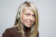 Menina com auriculares do telefone Foto de Stock Royalty Free