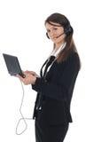 Menina com auriculares e netbook Fotos de Stock