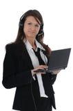 Menina com auriculares e netbook imagem de stock