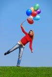 Menina com balões Fotografia de Stock