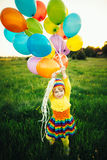 Menina com balões coloridos Fotos de Stock Royalty Free