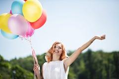 Menina com ballons coloridos Fotos de Stock