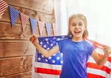 Menina com bandeira americana Fotografia de Stock