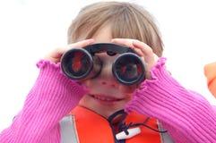 Menina com binóculos Imagem de Stock Royalty Free