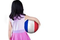 Menina com a bola no estúdio Imagem de Stock