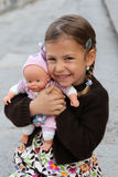 Menina com boneca Imagem de Stock Royalty Free
