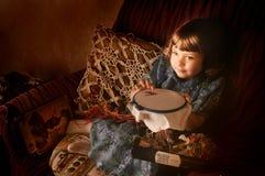 Menina com bordado Imagem de Stock