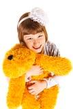 Menina com brinquedo Imagem de Stock