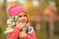 Menina com brinquedo Imagens de Stock