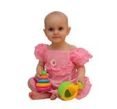Menina com brinquedos Foto de Stock Royalty Free