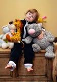 Menina com brinquedos Fotografia de Stock