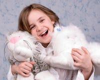 A menina com brinquedos Imagens de Stock Royalty Free