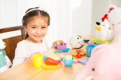 Menina com brinquedos Fotos de Stock