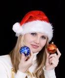 Menina com bulbo do Natal Fotografia de Stock Royalty Free