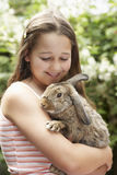Menina com Bunny Rabbit Imagem de Stock
