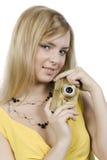 A menina com a câmera do ouro Imagem de Stock Royalty Free