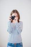 Menina com a câmera velha Foto de Stock Royalty Free