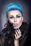 Menina com cabelo azul. Imagem de Stock