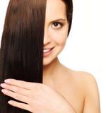Menina com cabelo de seda Foto de Stock Royalty Free