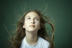 Menina com cabelo do vôo Imagens de Stock Royalty Free