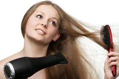 A menina com cabelo longo fotografia de stock