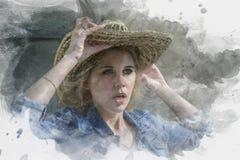 A menina com cabelo louro e olhos azuis em um chapéu de palha grande é surpri Foto de Stock