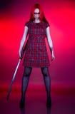 Menina com cabelo vermelho e uma espada Foto de Stock Royalty Free