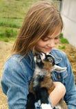 Menina com cabra do miúdo Foto de Stock Royalty Free