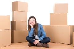 Menina com caixas Imagens de Stock Royalty Free