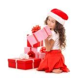 Menina com caixas de presente do Natal Isolado no branco Fotos de Stock Royalty Free