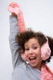 Menina com capa protectora para as orelhas cor-de-rosa e o lenço cor-de-rosa Foto de Stock Royalty Free
