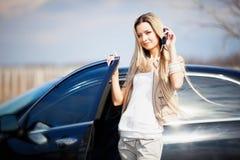 Menina com carro Imagem de Stock