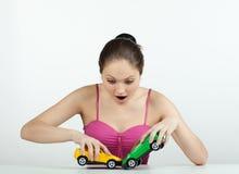 Menina com carros do brinquedo Imagens de Stock