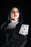 Menina com cartões de jogo Foto de Stock