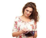 Menina com carteira à disposicão Imagem de Stock