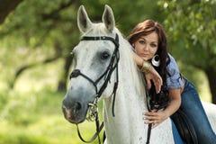 Menina com cavalo fotografia de stock royalty free