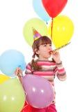 Menina com chapéu da trombeta e festa de anos dos balões Fotos de Stock Royalty Free