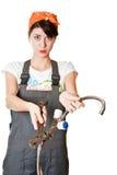 Menina com a chave inglesa que pede a ajuda Imagens de Stock Royalty Free