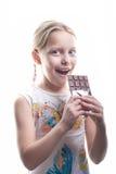 Menina com chocolate Fotografia de Stock