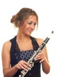 Menina com clarinet Fotografia de Stock